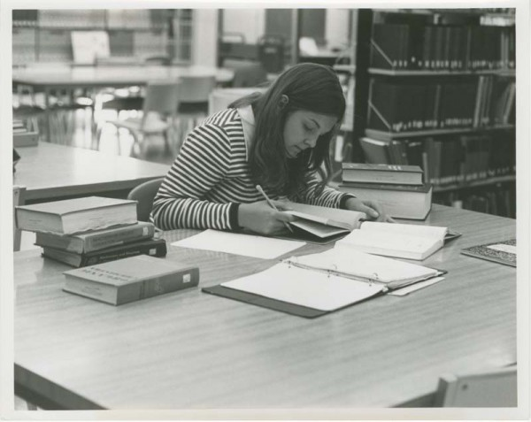 Female student studying at Kresge Library