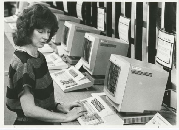 Librarian using computer terminal