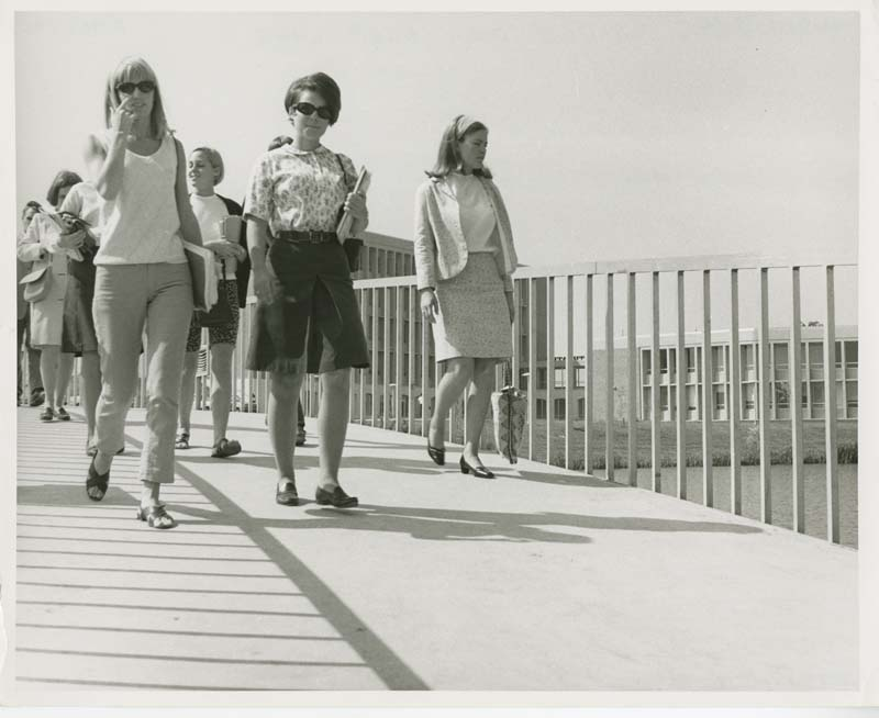 Photo of women walking across OU Vandenberg Bridge