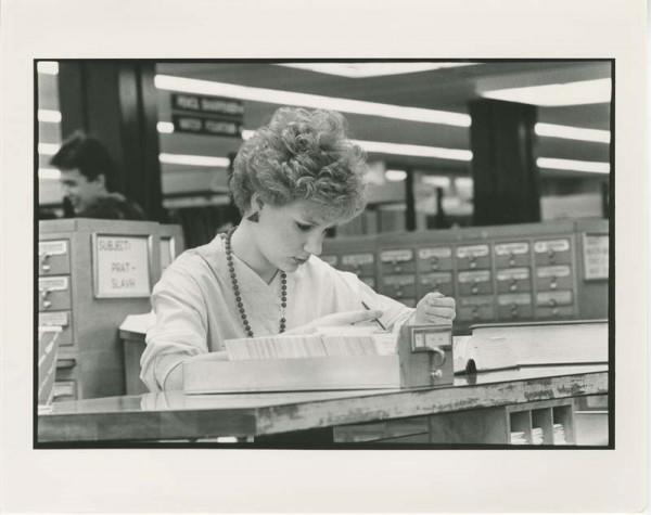 Student using library card catalogue