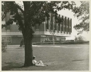 Student seated outside Kresge Library
