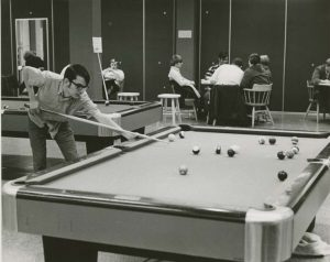 Students playing billiards in the OC in the 1970s